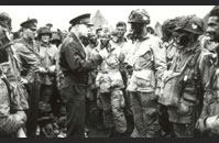 General Eisenhower - General Dwight D. Eisenhower, Supreme Commander of the Allied Expeditionary Force, speaks with Lieutenant Wallace C. Strobel, a paratrooper in the 101st Airborne Division, at Greenham Common airfield on the evening of June 5, 1944. Shortly after General Eisenhower's visit, the men of the 101st boarded C-47 troop transports and departed for Normandy.