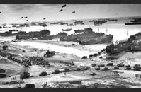 Allied Armada - The Allied armada disgorges its cargo on Omaha beach.  LSTs have beached themselves and are unloading vehicles as freighters stand further off and are unloaded by LVCPs and DUKWs. Gift of Jeffery M. Cole and Mary Egan, The National WWII Museum Inc., 2002.119