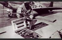Tuskegee Airman reloading plane artillery